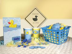 Ideas- Duck crossing sign, yellow/blue silverware with epoxy stickers, dollar store baskets, tablecloths, & streamers