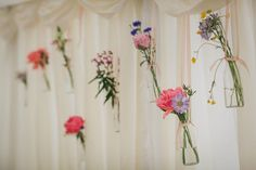 Hanging+Bottles+with+Wild+Flower+Stems+Wedding+Decor