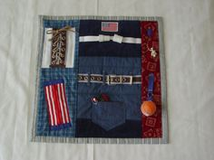 Busy Man Fidget Quilt- Tactile - Bright & Colorful- Fun for Alzhiemer Patients. $40.00, via Etsy.