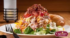 California Dreaming Salad - I'm going to try and make a version of this at home. Salad consists of lettuce, three different kinds of cheese, ham, turkey and bacon, tomatoes, slivered almonds for some crunch and honey mustard and hot bacon dressing. Yum!