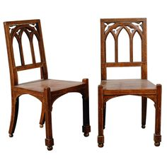 PAIR OF 19thC GOTHIC STYLE HALL CHAIRS | From a unique collection of antique and modern chairs at http://www.1stdibs.com/furniture/seating/chairs/