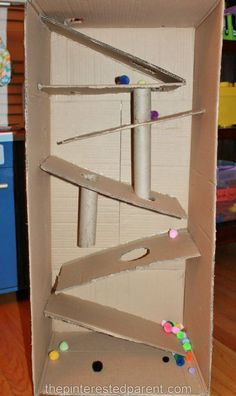 Cardboard Box Marble Run - Cardboard box marble & pom pom ramp. This was so much fun & a great activity for kids – arts & cr - Recycling For Kids, Diy For Kids, Crafts For Kids, Cardboard Box Crafts, Cardboard Toys, Cardboard Box Ideas For Kids, Cardboard Playhouse, Cardboard Furniture, Kids Craft Box