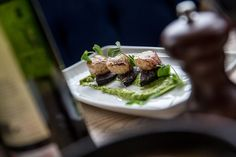 Pan fried scallops with black pudding and pea puree.