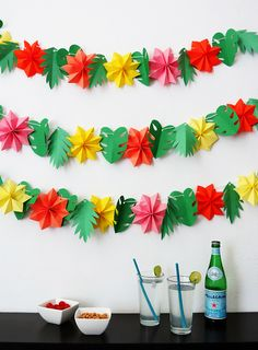 It's always nice to add a little extra decor if you host a party. One of the simplest things to do, is hanging a few garlands around. Today I will show you how to make a fun tropical garland with paper. Made of colorful flowers and tropical leaves, it's the perfect decor for any summer …