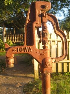 This pump is a lot like the one on our farm.  Iowa Farmhouse: Iowa Farmhouse Flower Garden