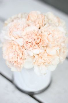 Cut costs by using Peach Carnations.  They look so romantic and no one will ever guess they are half the price!