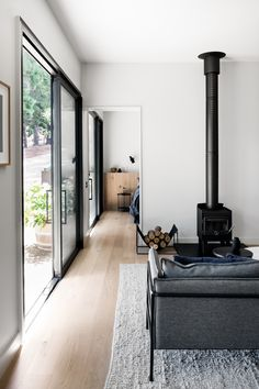 Originally a rustic, timber clad out-house designed by Eckersley Garden Architecture, the conversion of the Merrick's Guest House into a sophisticated Living Area, Living Room Decor, Living Spaces, Standing Fireplace, Brunswick House, Interior Design Awards, Interior Ideas, Home Studio, Cheap Home Decor