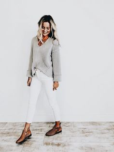 Simple gray sweater with white jeans.