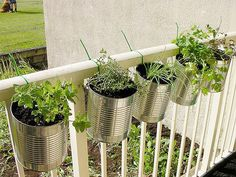 Outdoor Planter Projects • Tons of ideas & Tutorials! Including this project turning recycled cans into attractive planters.