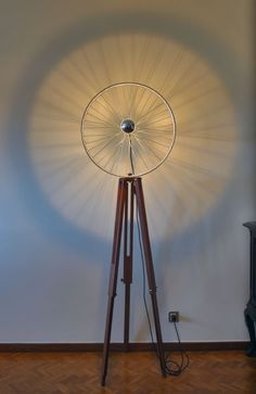 Stand lamp from a reused bike wheel with a half chrome bulb, and a self designer wooden tripod. with a black electrical wire and on/off switch. Due to the materials used and reused, each and every piece made, is unique. Wall Decor Crafts, Diy Home Crafts, Room Decor, Bicycle Decor, Home Room Design, Home And Deco, Unique Home Decor, Lamp Design, Decoration