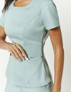Pintuck Top in Jade is a contemporary addition to women's medical scrub outfits. Shop Jaanuu for scrubs, lab coats and other medical apparel. Scrubs Outfit, Scrubs Uniform, Cute Nursing Scrubs, Doctor Scrubs, Stylish Scrubs, Casual Weekend Outfit, Medical Uniforms, Womens Scrubs, Medical Scrubs
