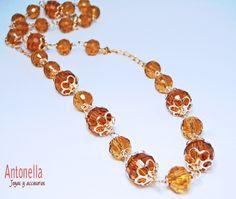 Código: collar-0001 Collar de cristales facetados color ámbar, elaborado en oro laminado.  #Necklace