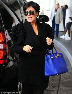 Go Mavericks! Kris Jenner flew the flag for Lamar's team by carrying this bag in his team colours in Miami today