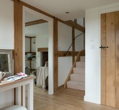 the warmth of new oak against pure white - lovely latch ironmongery on door by Border Oak - The Paper Mulberry: White