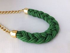 Green Fashionable Necklace made from braided bright and eye catching Para-cord. Several strands are used to transform this necklace into a