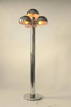 Chrome Floor Lamp in the style of Raak , Cantharelle , 1970s , USA | From a unique collection of antique and modern floor lamps at https://www.1stdibs.com/furniture/lighting/floor-lamps/