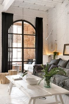 arched windows.... exposed brick. Black and white and grey and green...