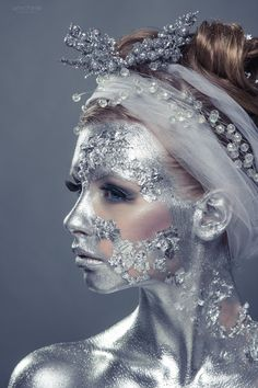 She was covered in jewels and pearls. Her skin was shiny silver and sparkled.in the morning sun