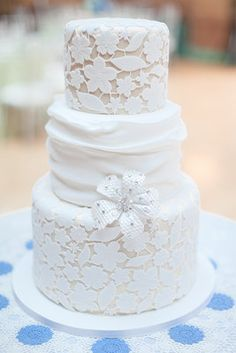 Lace fondant covered the sophisticated cake by Amy Beck Cake Design.