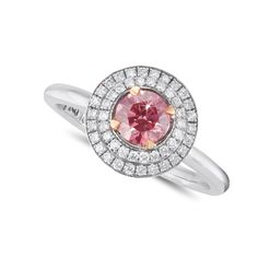 Rosea Pink Diamond Double Halo Engagement Ring.  A pink diamond is considered by many as the most feminine diamond with its mesmerizing hue. Our Rosea Engagement Ring is framed with two halos of brilliant white diamonds to highlight and compliment the central stone. The perfect way to ask that perfect person.  Featuring a GIA certified 0.47ct VS2 Pink round solitaire diamond, 48 brilliant white diamonds, set in 18kt white gold with 18kt rose gold tapered claws. Double Halo Engagement Ring, Designer Engagement Rings, Diamond Engagement Rings, Pink Sapphire, Blue Topaz, Double Mirror, Vintage Cushions, Solitaire Diamond, White Diamonds