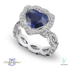 """Katharine James Fine Jewelry """"Bella's Love"""" platinum fashion ring with a heart-cut sapphire and diamonds."""