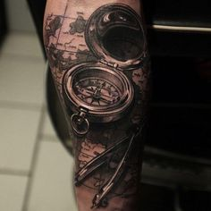 Realistic compass and map tattoo - 100 Awesome Compass Tattoo Designs