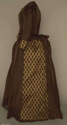 """BROWN SILK BUSTLE DRESS, 1880s   Chocolate brown faille & brown velvet cut to copper satin in small grape clusters, bodice w/ copper round bead trim & ecru lace, pleated a-symmetrical skirt, silk fringe trim on 1 panel, B 33"""", W 25"""", Skirt L 42.5"""", (bodice altered from closed neck to V, lace damaged) very good."""