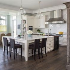 Subway tile can give a kitchen a classic vibe in a snap. Browse these timeless kitchens with subway tile backsplashes. Laundy Room, Kitchen Design, Classic Kitchens, Laundry Room, Subway Tile Kitchen, House, Kitchen On A Budget, Oak Kitchen, Timeless Kitchen