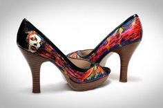 This shoe design uses a more controlled, intentional paint splatter design, and is bright and pops from black background; it's attention-getting and a little edgy. The white face near the heel of the shoe is interesting, but the design would be better off without it. Instead, the swooping colors that move along the curve of the shoe should just fade into the heel.