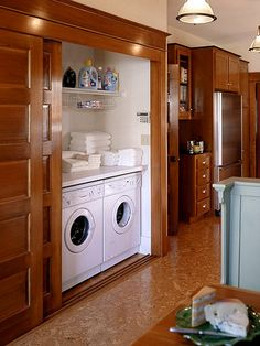 Tuck the washer and dryer into the pantry and hide everything behind sliding paneled doors that match the room's other doors. Install a countertop over the appliances for place to fold clothes. Wall-hung wire shelves keep laundry supplies within reach.