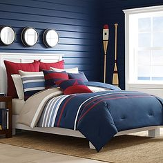 Update your room with a classic look with the Nautica Bradford Duvet Cover Set featuring bold, colorful block stripes with double needling. In a classic palette of navy, red, taupe, grey and white the set is a charming accent in any space.