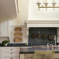 Slate backsplash in kitchen by Giannetti Home