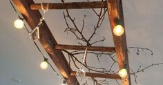 An Ideas About Patio & Lighting: A vintage wooden ladder makes great lighting! This one is wrapped with globe lights and decorated with vintage chandelier crystals and branches. There are endless variations on this theme!