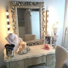 Ikea Musik lights, antique mirror, vanity spray painted with ivory.. love!