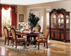 "INCLUDES:  TABLE WITH 2 X 15"" LEAF, 6 SIDE CHAIRS, AND 2 ARM CHAIRS.     The Chateau De Ville traditional dining collection features elegant styling, decorative"