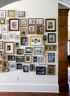 gallery wall (i think this would probably work best with sepia-toned and black-and-white photographs and a series of wooden and gilded frames)