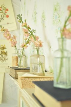 love the vases and using old books as decor....want to try this above our fireplace