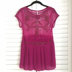"""Free People Beaded Party Top Sheer beaded party top with nylon """"skirt"""" -- I'm wearing it over a black cami in the photo but I think it looks better with a nude one. It is NWOT but there are loose threads on the bottom that look intentional. Free People Tops"""