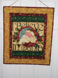 Santa wall hanging turquoise red green by ExpressionQuilts on Etsy, $27.00
