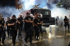 Police in Istanbul advance on Protesters on Istiklal St. near Gezi Park.