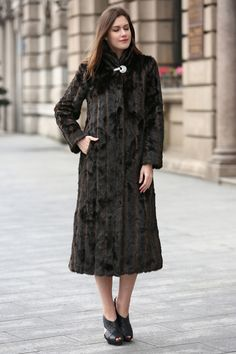 - 100% Modacrylic, Summit faux Mink fur - Dry Clean Only - Modest sensuality with definitive sophistication - 100% handmade with luxe and elegance in mind - Full-length with turtleneck collar, center