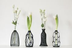 3D printed bottle covers designed by @DesignLibero turn a PET bottle into a vase