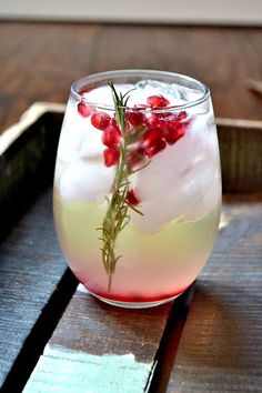 Pomegranate and Rosemary White Sangria - Dry White Wine, Pomegranate Arils, Rosemary, Simple Syrup, Lemon Juice, Orange Juice, Triple Sec.