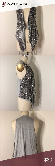 Sparkle vest Fun sequined vest by Dolan! Light grey heather jersey, large silver sequins. Made in USA:) this looks in excellent condition. However, as is the case with this sort of garment, you may find you leave a little pixie trail when wearing it. dolan Tops