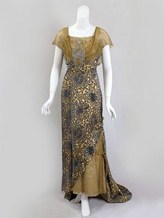 Devoré velvet evening dress trimmed with metallic lace, c.1910.
