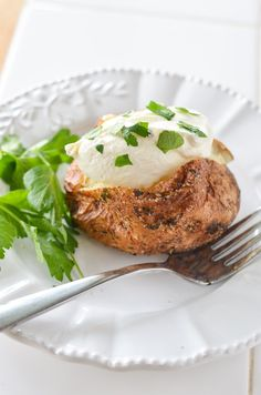 Air Fryer Baked Potato covered with a parsley garlic salt rub. Making Air Fryer Baked Potatoes will be your new favorite way to use your air fryer. Our air fryer baked potatoes are a reader favorite, one of our favorite ways to use our air fryer and definitely one of the best air fryer recipes!