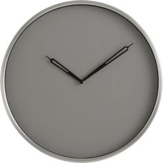 Minimalist hands mark the time on a handsome disk of cool grey recessed and ringed in steel.  Styled clean and modern without numerals as an understated focal point to home or office wall. GlassPlastic backingSteel frameMetal handsRequires on AA battery (not included)Made in China.