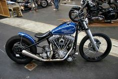"Blue Shovelhead hardtail custom with 41mm fuel lowers, 21""front wheel with disc brake"