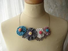 bib statement colorful fabric flower necklace with resin flowers and metal lace. $15.00, via Etsy.