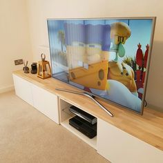 Ikea besta TV stand with an oak wood top. Custom design.